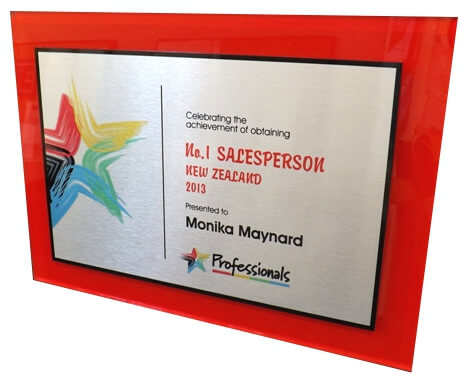 Large metal corporate awards plaque engraved with colour logos and text.